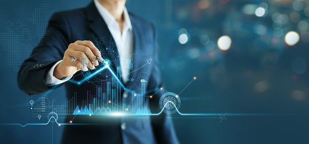 Businessman drawing growth graph chart sales and data economic on global structure networking connection. 1165049242