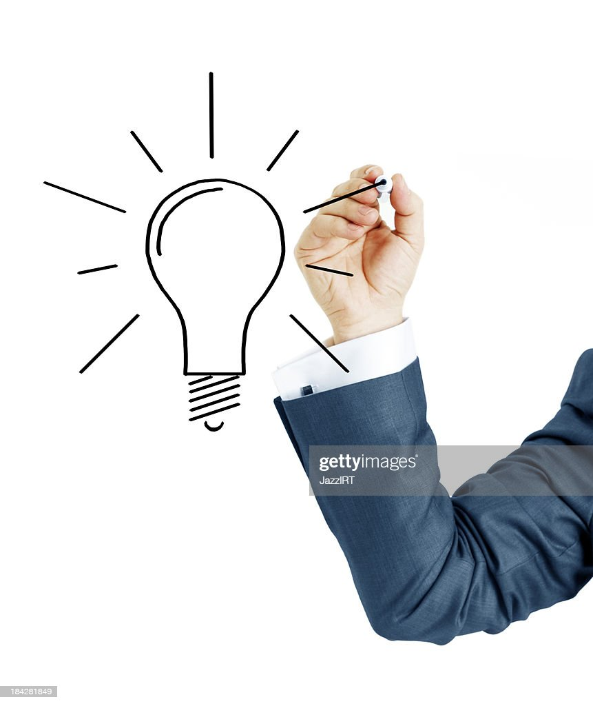 Businessman Drawing Idea Lamp Stock Photo