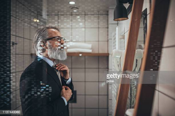 businessman dressing up - adjusting necktie stock pictures, royalty-free photos & images