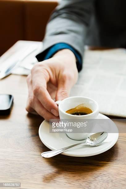 Businessman drinking cappuccino