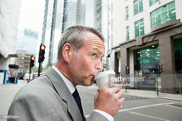 Businessman drinking coffee on the go