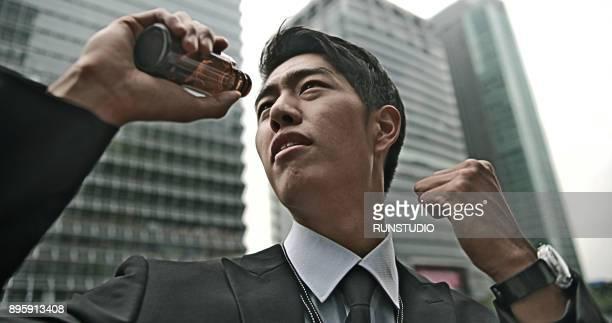Businessman drinking energy drink