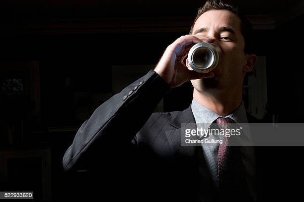 Businessman Drinking from Aluminum Can
