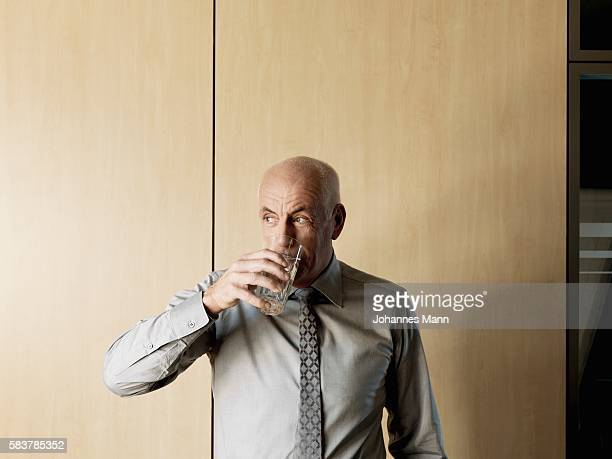 Businessman drinking glass of water
