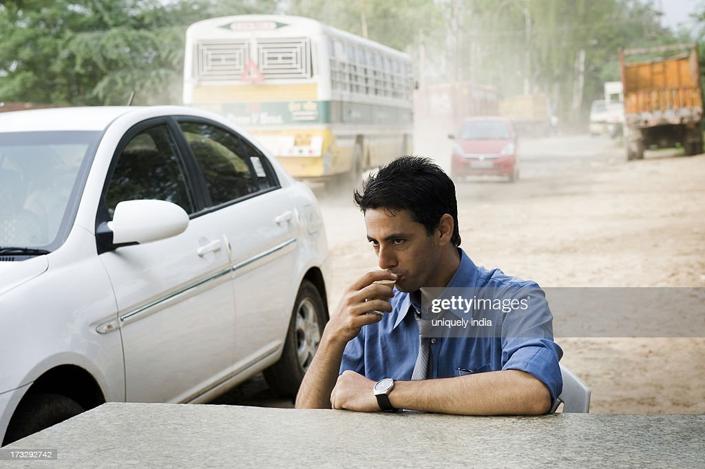 Businessman drinking tea : Stock Photo