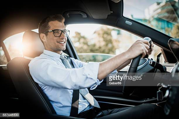 businessman driving a car - driving stock pictures, royalty-free photos & images