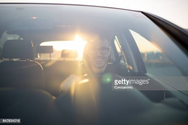 businessman driving a car. - driver stock photos and pictures