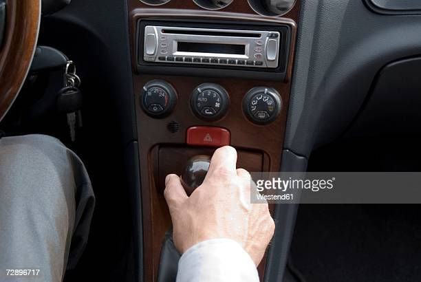 Businessman driving car, close-up