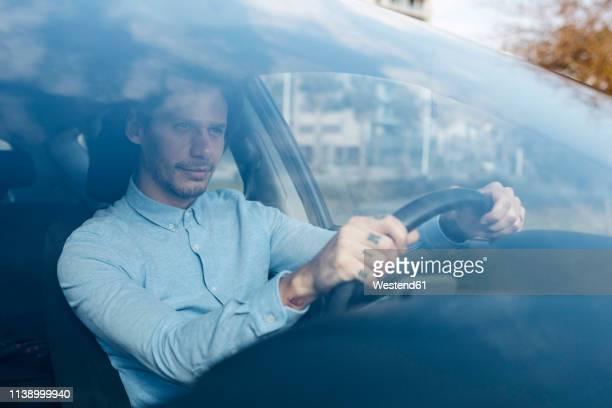 businessman driving car - human body part - fotografias e filmes do acervo