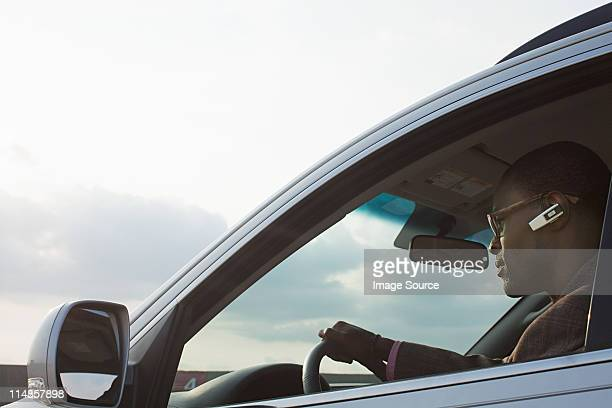 businessman driving car - bluetooth stock pictures, royalty-free photos & images