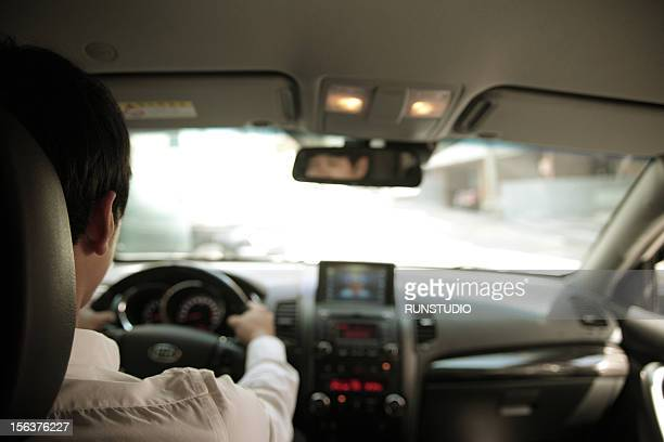 businessman driving car - vehicle interior stock pictures, royalty-free photos & images