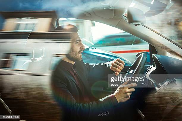businessman driving car - dringendheid stockfoto's en -beelden