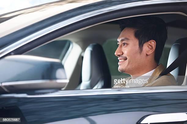 Businessman driving in car