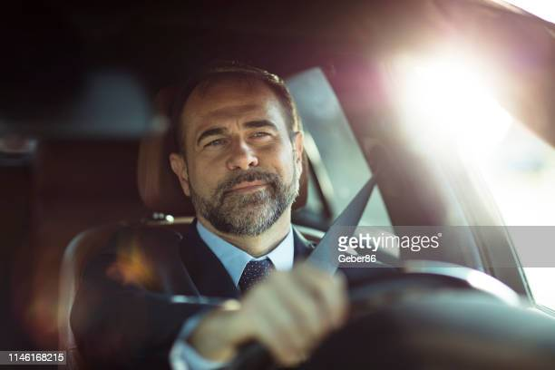 businessman driving - steering wheel stock pictures, royalty-free photos & images