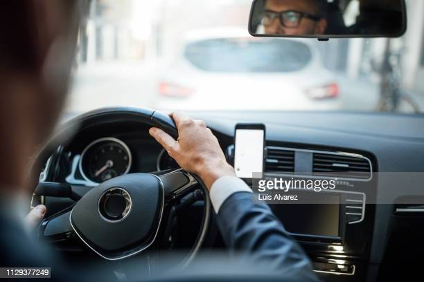 businessman driving the car - one man only stock pictures, royalty-free photos & images