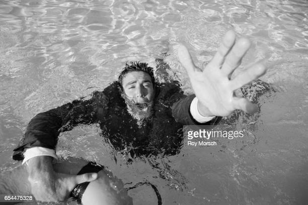 Businessman Drowning in Pool