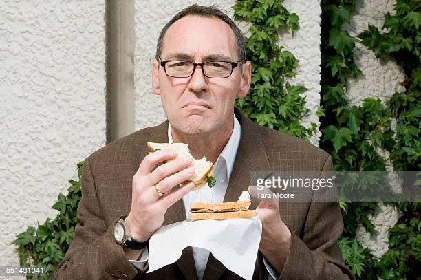 Businessman Eating a Sandwich
