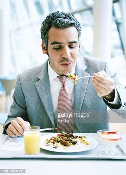 Businessman eating lunch, close-up