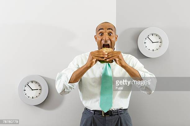 Businessman Eating Quick Lunch