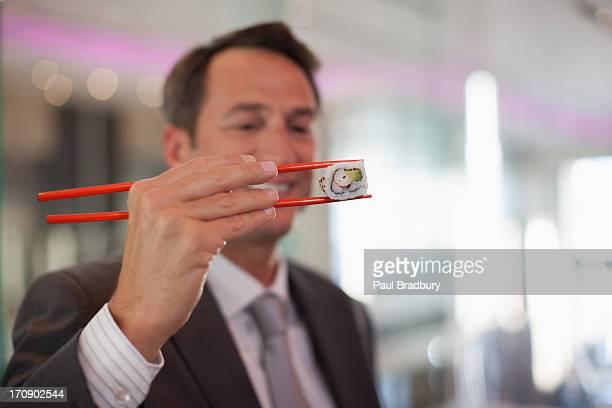Businessman eating sushi