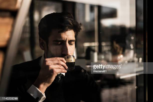 businessman enjoying his coffee - lebensfreude stock-fotos und bilder