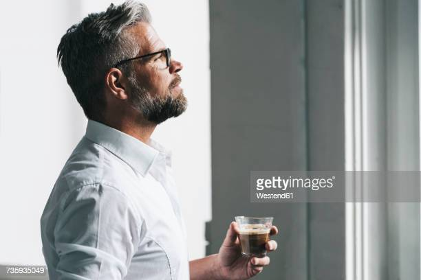 Businessman enjoying his coffee