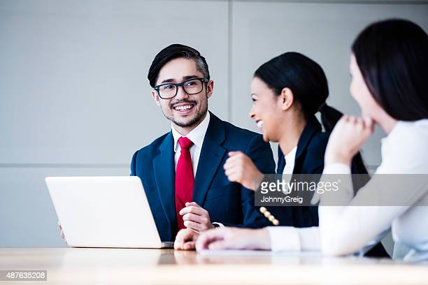 Businessman enjoying meeting with colleagues