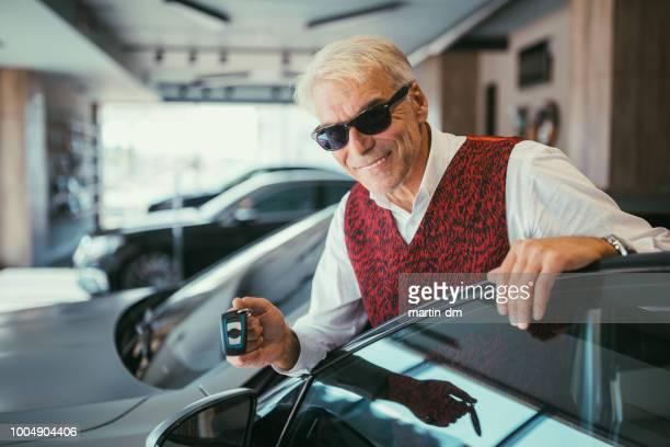 businessman enjoying new car - cool cars stock pictures, royalty-free photos & images