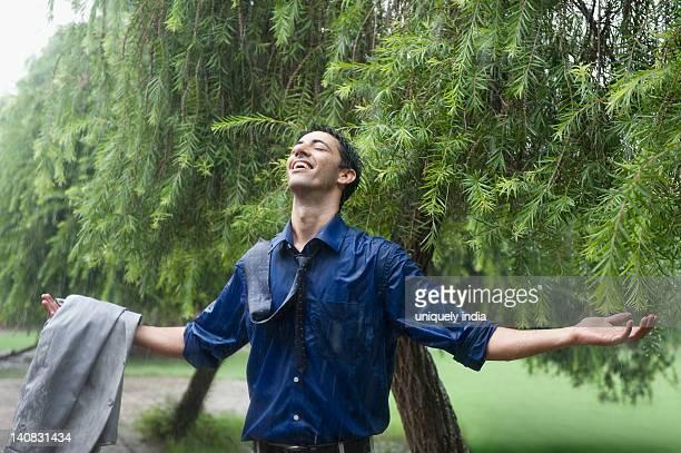 businessman enjoying rain - exhilaration stock photos and pictures