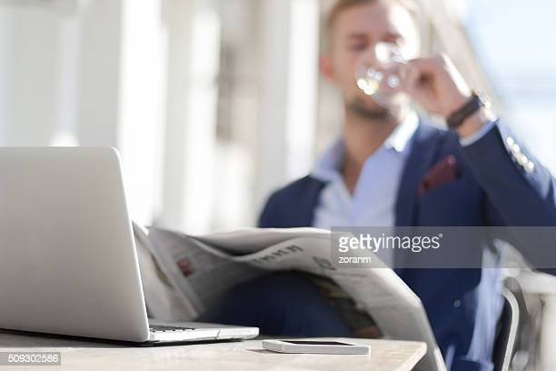 Businessman enjoying white wine