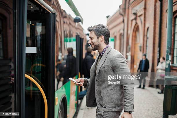 Businessman entering a bus