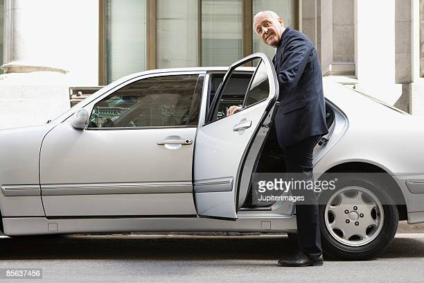 Businessman entering car