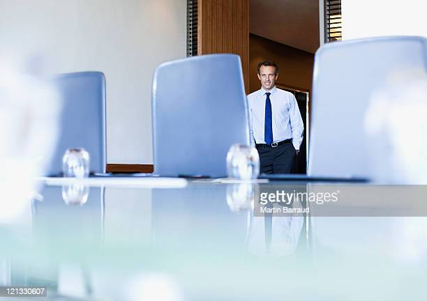 businessman entering conference room - chairperson stock pictures, royalty-free photos & images