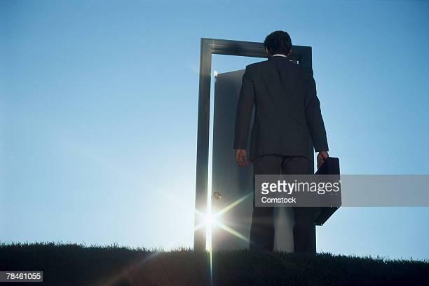 Businessman entering door outdoors