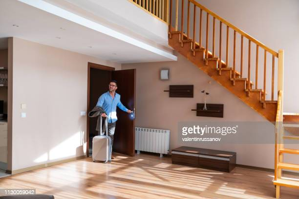 businessman entering his hotel - returning stock pictures, royalty-free photos & images
