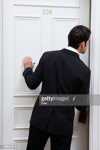 Businessman Entering Hotel Room