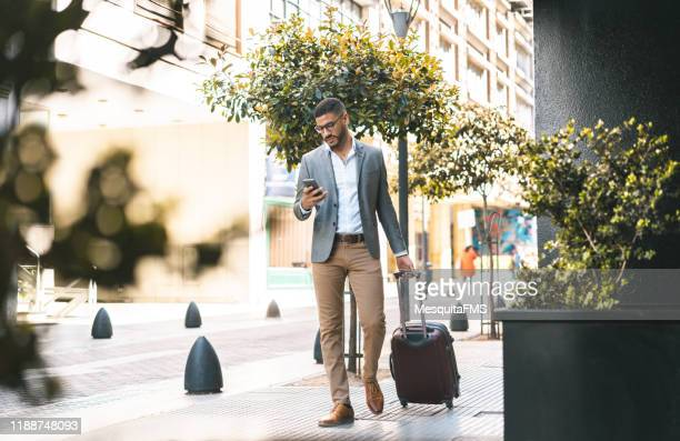 businessman entering in hotel - entering stock pictures, royalty-free photos & images