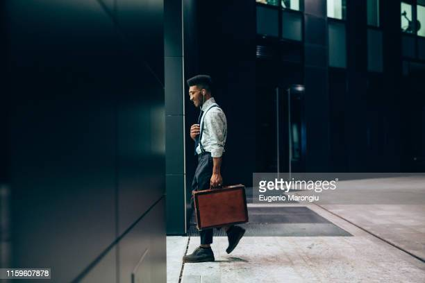 businessman entering office building, milano, lombardia, italy - entering stock pictures, royalty-free photos & images
