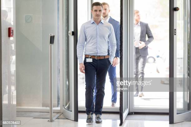 Businessman entering office building