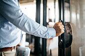 Businessman entering office cabin