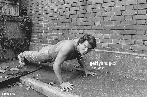 Businessman entrepreneur and actor Bernard Tapie does pushups outside his home
