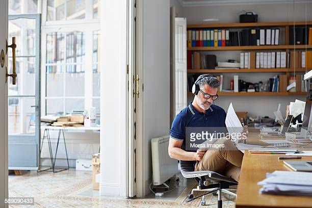 businessman examining documents at desk - document stock pictures, royalty-free photos & images