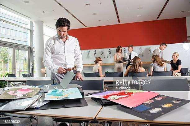 Businessman examining fabric swatches