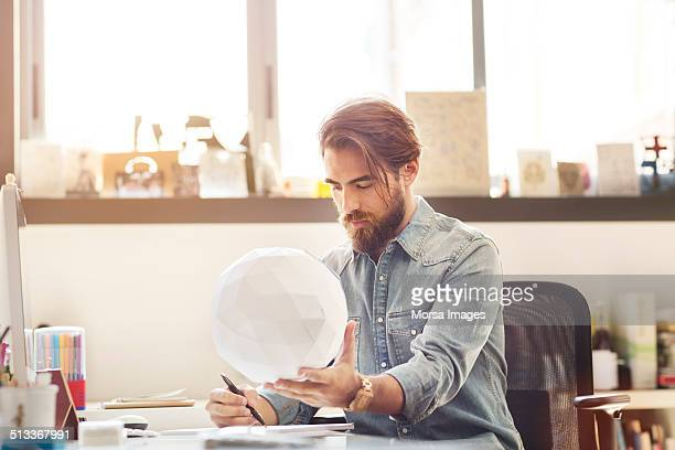 Businessman examining model