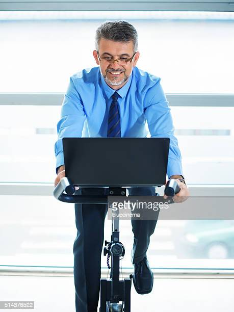 Businessman spinning in fitness