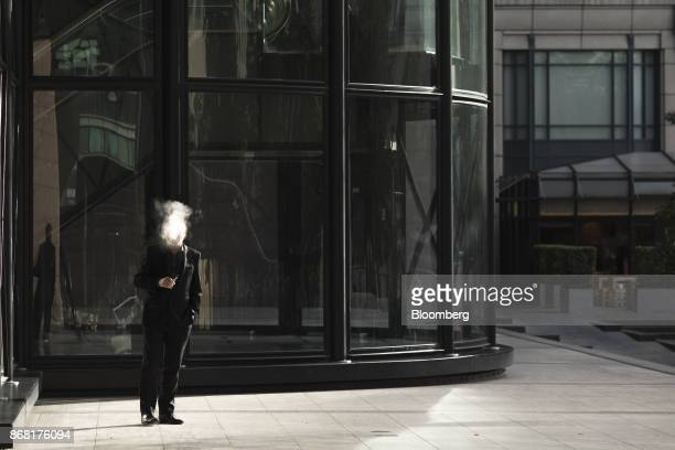 A businessman exhales vapor while using an electronic cigarette outside an office building in the City of London UK on Monday Oct 30 2017 The Bank of...