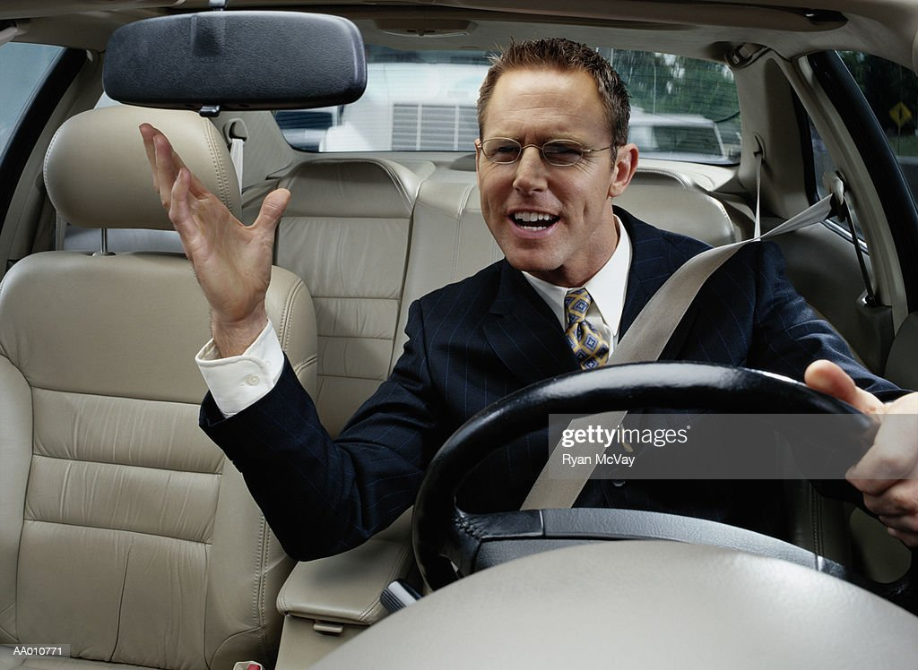 Businessman Experiencing Road Rage While Driving : Stock Photo