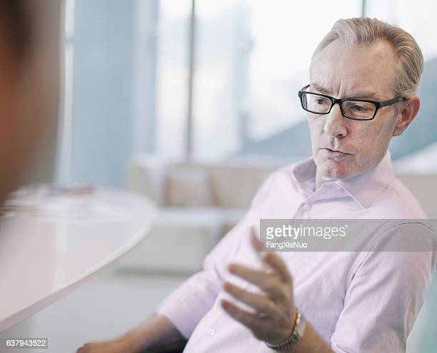 Businessman explaining idea to colleague in meeting