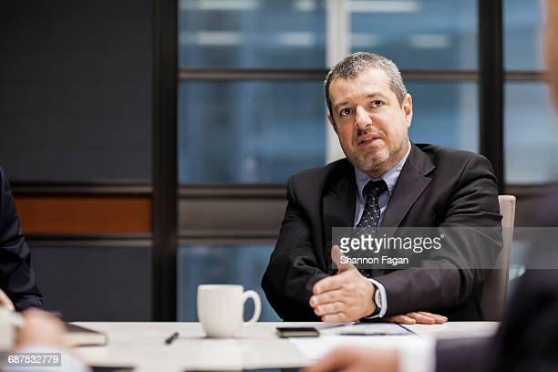 Businessman explaining positioning in meeting