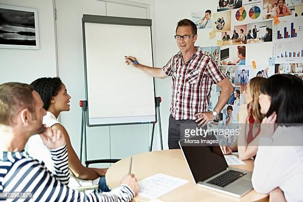 Businessman explaining project